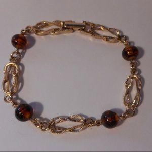 Vintage Avon Gold Tone Knot Brown Bead Bracelet